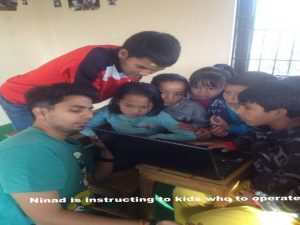 Volunteers in an Orphanage in Nepal teaching children about the internet